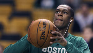 Photo - Boston Celtics guard Rajon Rondo takes a shot prior to the Celtics' NBA basketball game against the Toronto Raptors, in Boston on Wednesday, Jan. 15, 2014. Rondo took a step toward returning to action on Wednesday, working out with members of Boston's NBA Development League team at the Celtics' practice facility earlier in the day. (AP Photo/Charles Krupa)