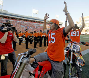 Photo - Former OSU golfer Rickie Fowler acknowledges the crowd before a college football game between the Oklahoma State University Cowboys (OSU) and the University of Arizona Wildcats at Boone Pickens Stadium in Stillwater, Okla., Thursday, Sept. 8, 2011. Photo by Bryan Terry, The Oklahoman  ORG XMIT: KOD