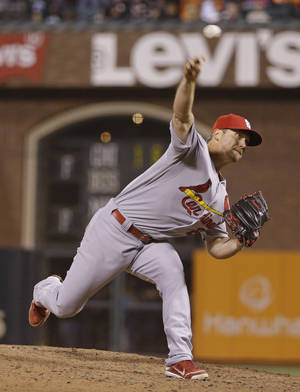 Photo - St. Louis Cardinals closing pitcher Trevor Rosenthal throws against the San Francisco Giants in the ninth inning of a baseball game Wednesday, July 2, 2014, in San Francisco. St. Louis won the game 2-0 and Rosenthal got his 25th save of the season. (AP Photo/Eric Risberg)