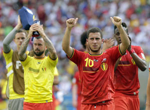 Photo - Belgium's Eden Hazard (10) and his teammates applaud spectators following Belgium's 1-0 victory over Russia during the group H World Cup soccer match between Belgium and Russia at the Maracana Stadium in Rio de Janeiro, Brazil, Sunday, June 22, 2014. (AP Photo/Bernat Armangue)