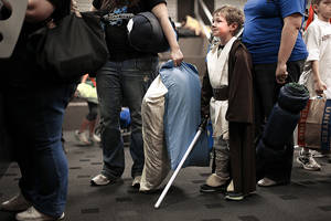 Photo - Jacob Babcock, 5, of Altus, waits in line to get into Science Museum Oklahoma for the Bright Night of Star Wars sleepover.