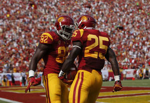 Photo -   Southern California running back Silas Redd, right, celebrates his touchdown with tight end Randall Telfer during the first half of an NCAA college football game against California in Los Angeles, Saturday, Sept. 22, 2012. (AP Photo/Jae C. Hong)