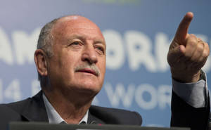 Photo - Brazil's soccer coach Luiz Felipe Scolari gives a news conference at a Team Workshop for the 2014 World Cup at the Costao do Santinho hotel in Florianopolis, Brazil, Wednesday, Feb. 19, 2014. (AP Photo/Andre Penner)