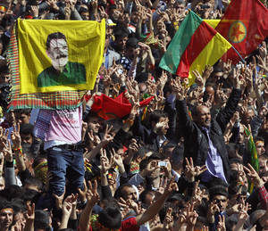 Photo - Some thousands of supporters demonstrate waving various PKK flags and images of jailed Kurdish rebel leader Abdullah Ocalan, in southeastern Turkish city of Diyarbakir, Turkey, Thursday, March 21, 2013. Ocalan called Thursday for an immediate cease-fire and for thousands of his fighters to withdraw from Turkish territory, a major step toward ending the fighting for self-rule for Kurds in southeastern Turkey, one of the world's bloodiest insurgencies lasting nearly 30-years and costing tens of thousands of lives.(AP Photo)