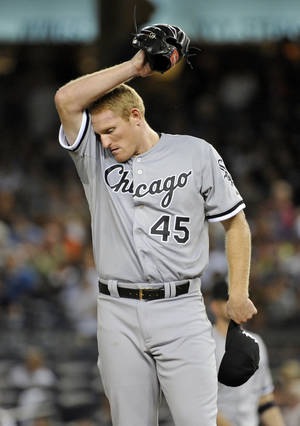 Photo - Chicago White Sox pitcher Erik Johnson wipes his face during the fourth inning of a baseball game against the New York Yankees Wednesday, Sept. 4, 2013, at Yankee Stadium in New York. (AP Photo/Bill Kostroun)