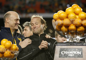 photo - West Virginia's head coach Dana Holgorsen, right, is congratulated following their victory in the Orange Bowl NCAA college football game, Wednesday, Jan. 4, 2012, in Miami. West Virginia defeated Clemson 70-33. (AP Photo/Lynne Sladky) ORG XMIT: SLS139