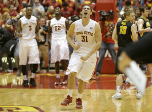 Photo - Iowa State forward Georges Niang (31) reacts at the end of an NCAA college basketball game against Iowa, Friday, Dec. 13, 2013, in Ames, Iowa.  Niang scored 24 points as Iowa State won 85-82. (AP Photo/Charlie Neibergall)
