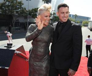 Photo - Pink, left, and Carey Hart arrive at the MTV Video Music Awards on Thursday, Sept. 6, 2012, in Los Angeles. (Photo by Matt Sayles/Invision/AP)