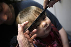 photo - Vona Hankins cuts the hair of Nathan Marshall, who is the sixth generation of a family that has been seeing Hankins for haircuts in Oklahoma City. Photos by Garett Fisbeck, The Oklahoman