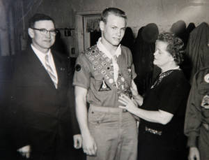 Photo - This is a copy of an Oct. 16, 1959, photo of Hal Yocum, center, and his parents, John and Evelyn, at a Court of Honor.