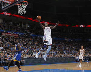 photo - Oklahoma City 's Kevin Durant (35) takes a shot during an NBA basketball game between the Oklahoma City Thunder and the Golden State Warriors at Chesapeake Energy Arena in Oklahoma City, Sunday, Nov. 18, 2012.  Photo by Garett Fisbeck, The Oklahoman