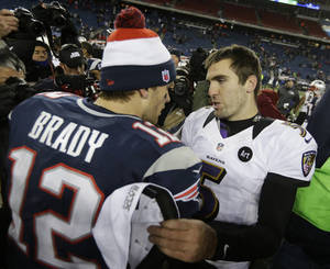 Photo - Baltimore Ravens quarterback Joe Flacco, right, talks to New England Patriots quarterback Tom Brady following the NFL football AFC Championship football game in Foxborough, Mass., Sunday, Jan. 20, 2013. The Ravens defeated the Patriots 28-13 to advance to Super Bowl XLVII. (AP Photo/Steven Senne)