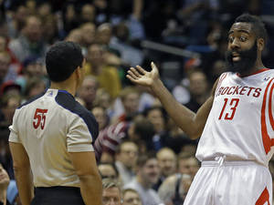 Photo - Houston Rockets' James Harden (13) argues a call by referee Bill Kennedy (55) during the first half of an NBA basketball game Saturday, Feb. 8, 2014, in Milwaukee. (AP Photo/Jeffrey Phelps)