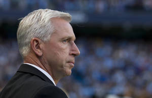 Photo - Newcastle's manager Alan Pardew watches his team's English Premier League soccer match against Manchester City at The Etihad Stadium, Manchester, England, Monday Aug. 19, 2013. (AP Photo/Jon Super)