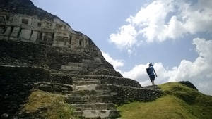 """Photo - This April 26, 2014, photo shows a modern copy of an ancient frieze on the structure known as """"El Castillo"""" at the archeological site of Xunantunich.  Despite its lofty appearance and elaborate decorations, the Castillo likely served as an administrative hub, not a temple, according to the visitor's center. (AP Photo/Alina Hartounian)"""