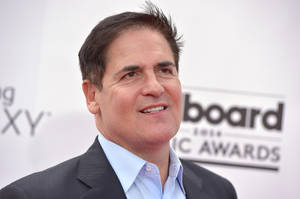 Photo - Mark Cuban arrives at the Billboard Music Awards at the MGM Grand Garden Arena on Sunday, May 18, 2014, in Las Vegas. (Photo by John Shearer/Invision/AP)