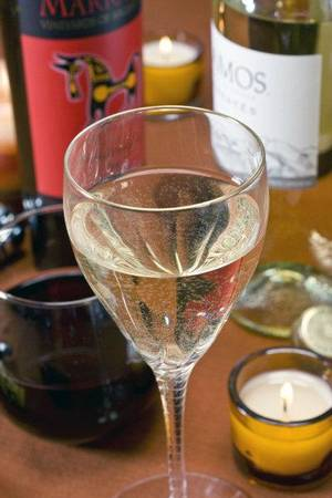 photo - This file photo shows a glass of wine. An industry report says grapes will be in short supply in the next few years. AP FILE PHOTO &lt;strong&gt;Larry Crowe - AP&lt;/strong&gt;