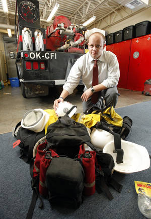 Photo - Mark Masters, president of Chloeta Fire LLC, shows some of the company's equipment. Photos by Steve Sisney, The Oklahoman