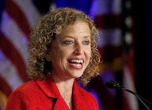 Photo - FILE - This Aug. 23, 2013 file photo shows Democratic National Committee chair, Rep. Debbie Wasserman Schultz, D-Fla. speaking in Scottsdale, Ariz. Democrats plan to travel to six cities this summer to evaluate potential sites for the 2016 Democratic National Convention. Officials with the Democratic National Committee are studying how each city might accommodate the tens of thousands of party leaders and activists who will flock to the convention, where the party will nominate its next presidential candidate. Wasserman Schultz is expected to announce the host city later this year or in early 2015.  (AP Photo/Ross D. Franklin, File)