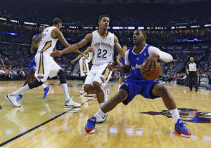 Photo - Los Angeles Clippers guard Chris Paul (3) tries to get around New Orleans Pelicans guard Brian Roberts (22) in the first half of an NBA basketball in New Orleans, Monday, Feb. 24, 2014.  (AP Photo/Bill Haber)