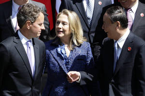 Photo -   Chinese Vice Premier Wang Qishan, right, talks to U.S. Treasury Secretary Timothy Geithner, left, and U.S. Secretary of State Hillary Rodham Clinton as they attend a group photo after the opening ceremony of U.S.-China Strategic and Economic Dialogue at the Diaoyutai state guesthouse in Beijing, Thursday, May 3, 2012. (AP Photo/Jason Lee, Pool)