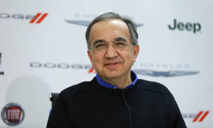 Photo - Fiat and Chrysler CEO Sergio Marchionne speaks during media previews during the North American International Auto Show in Detroit, Monday, Jan. 13, 2014. (AP Photo/Paul Sancya)