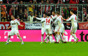 Photo -   Leverkusen's player's celebrate after scoring during the German first division Bundesliga soccer match between FC Bayern Munich and Bayer 04 Leverkusen in Munich, Sunday, Oct. 28, 2012. (AP Photo/Kerstin Joensson)
