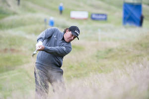Photo - U.S. golfer Phil Mickelson  plays from the rough on the 4th hole during day one of the Scottish Open at Royal Aberdeen golf course, Aberdeen Scotland Thursday July 10, 2014. (AP Photo/Kenny Smith/PA) UNITED KINGDOM OUT