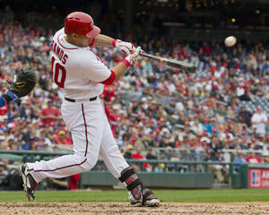Photo - Washington Nationals Wilson Ramos hits a go-ahead sacrifice fly against the Los Angeles Dodgers pitcher Dan Haren during the fifth inning of a baseball game, Wednesday, May 7, 2014 in Washington. Nationals won 3-2. (AP Photo/Pablo Martinez Monsivais)