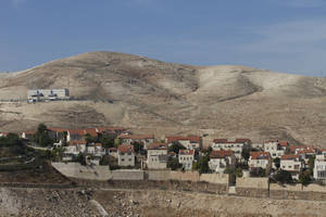 Photo - A view of  the Jewish West Bank settlement of Maaleh Adumim, with E1, background, near Jerusalem, Sunday, Dec. 2, 2012. Israel on Sunday roundly rejected the United Nations' endorsement of an independent state of Palestine, and announced it would withhold more than $100 million owed to the Palestinians in retaliation for their successful statehood bid. Israel has a master plan to build 3,600 apartments and 10 hotels on the section of territory east of Jerusalem known as E1. The Palestinians have warned that such construction would kill any hope for the creation of a viable state of Palestine. (AP Photo/Ariel Schalit)