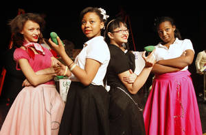 "Photo - Cast members Madison Belanger, Samiya Bryant, Violieta Mustofa and Shydae Hamilton prepare to perform in ""Attack of the Killer Grasshoppers,"" at John Marshall High School."