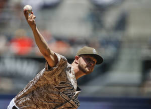 Photo - San Diego Padres starting pitcher Jesse Hahn throws against the San Francisco Giants in the first inning of a baseball game Sunday, July 6, 2014, in San Diego.  (AP Photo/Lenny Ignelzi)