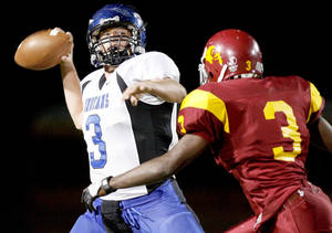 photo - Little Axe's Daniel Leonard, left, tries to pass over Centennial's Kourtney Williams during a game in Spencer on Oct. 23, 2008. Leonard is one of seven starters back on offense for the Indians.PHOTO BY BRYAN TERRY, THE OKLAHOMAN ARCHIVE