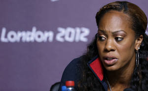 "photo -   United States runner Sanya Richards-Ross speaks during a news conference at Olympic Park during the 2012 Summer Olympics, Monday, July 30, 2012, in London. Richards-Ross is one of the U.S. athletes who are part of a Twitter campaign demanding changes in Olympic Rule 40 — which, among other things, does not permit athletes ""to promote any brand, product or service within a posting, blog or tweet or otherwise on any social media platforms or on any websites."" (AP Photo/Matt Rourke)"