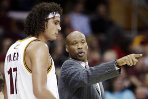 Photo - Cleveland Cavaliers head coach Byron Scott, right, instructs Anderson Varejao, of Brazil, in the first half of an NBA basketball game against the Toronto Raptors, Tuesday, Dec. 18, 2012, in Cleveland. Toronto won 113-99. (AP Photo/Mark Duncan)