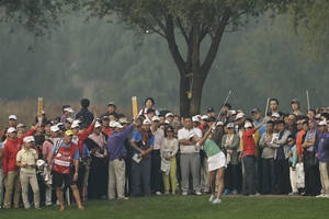 Photo - Spectators watch Jessica Korda of the United States driving a ball on the 18th hole during the second round of the Reignwood LPGA Classic golf tournament at Pine Valley Golf Club on the outskirts of Beijing, China, Friday, Oct. 4, 2013. (AP Photo/Alexander F. Yuan)