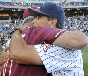 Photo -   Florida State coach Mike Martin, left, and Arizona coach Andy Lopez hug following an NCAA College World Series baseball game in Omaha, Neb., Thursday, June 21, 2012. Arizona defeated Florida State 10-3. (AP Photo/Dave Weaver)