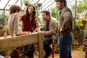 "Photo - This film image released by Disney shows, from left, Cameron ""CJ"" Adams, Jennifer Garner, Lin-Manuel Miranda, Joel Edgerton in a scene from ""The Odd Life Of Timothy Green."" (AP Photo/Disney, Phil Bray) ORG XMIT: NYET231"