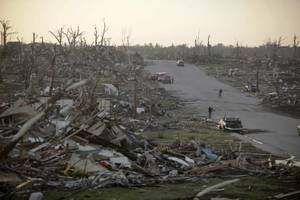 photo - A residential neighborhood in Joplin, Mo., is seen Monday, May 23, 2011 after it was leveled by a tornado that destroyed nearly 30 percent of the town on Sunday afternoon. The twister cut a six-mile path through the city. (AP Photo/Tulsa World, Adam Wisneski) 