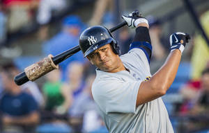 Photo - In this Monday, July 15, 2013, photo, New York Yankees third baseman Alex Rodriguez warms up before batting against the Reading Fightin Phils, during his rehab appearance with the Trenton Thunder in Reading, Pa. (AP Photo/PennLive.com, Christine Baker)