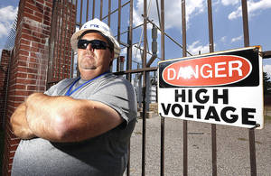 Photo - Carl Mize poses at a substation in Norman, Monday July 1, 2013. Mize has been struck by lightning six times. Photo By Steve Gooch, The Oklahoman
