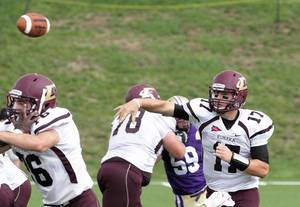 photo -   This image provided Eureka College shows quarterback Sam Durley passing during the game against Knox College Saturday Sept. 1, 2012 in a 62-55 victory over Knox to break the NCAA single-game passing record. Durley broke an NCAA single-game passing record with 736 passing yards Saturday. He completed 34 of 52 passes and threw for five touchdowns, including two in the final two minutes as the Red Devils closed the Division III game with 17 unanswered points. (AP Photo/Bob Hunt, Eureaka College)