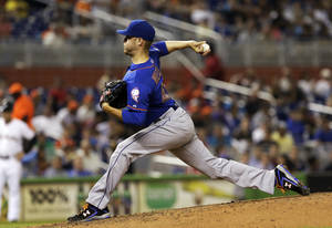 Photo - New York Mets' Zack Wheeler pitches against the Miami Marlins in the fourth inning of a baseball game in Miami, Thursday, June 19, 2014. (AP Photo/Alan Diaz)