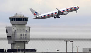 Photo - FILE - In this Friday, Oct. 14, 2011 photo, an American Airlines Boeing 767 takes off from Miami International Airport, in Miami. American Airlines Group Inc. releases quarterly financial results before the market opens on Thursday, April 24, 2014. (AP Photo/Wilfredo Lee, File)