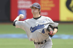 Photo - Creighton pitcher Bryan Sova throws in the fifth inning of their NCAA college baseball game against Seton Hall in the Big East Conference tournament, Saturday, May 24, 2014, in New York. Creighton won 2-1. (AP Photo/John Minchillo)