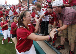 Photo - Pitcher Keilani Ricketts celebrates with fans at the NCAA Super Regional softball game as the University of Oklahoma (OU) Sooners defeat Texas A&M 8-0 at Marita Hines Field on Saturday, May 25, 2013 in Norman, Okla. to advance to the College World Series. Photo by Steve Sisney, The Oklahoman