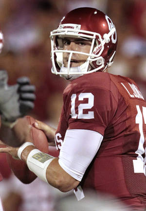 photo - Oklahoma's Landry Jones (12) passes for a touchdown during the college football game between the University of Oklahoma Sooners (OU) and the University of Missouri Tigers (MU) at the Gaylord Family-Memorial Stadium on Saturday, Sept. 24, 2011, in Norman, Okla. Photo by Steve Sisney, The Oklahoman