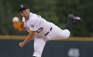 Photo - Colorado Rockies starting pitcher Jorge De La Rosa throw to a San Diego Padres batter in the first inning of a baseball game in Denver, Friday, May 16, 2014. (AP Photo/Joe Mahoney)
