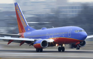Photo -  A Southwest Airlines jet plane lands at Love Field  in Dallas.  AP File Photo  <strong>LM Otero -  AP </strong>