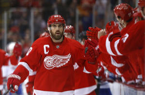 Photo - Detroit Red Wings left wing Henrik Zetterberg (40), of Sweden, celebrates his goal against the Montreal Canadiens in the first period of an NHL hockey game, Friday, Jan. 24, 2014, in Detroit. (AP Photo/Paul Sancya)